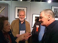 Rev. Morrow talks to a critic during the opening of the Vanishing America exhibit