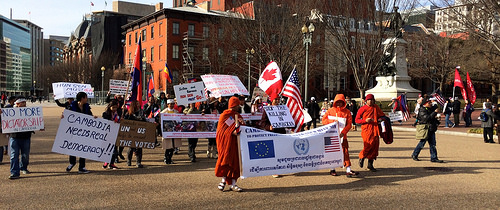 Buddhist monks and other Cambodians protest at the White House on MLK day. They had dictator Hun Sen firmly in their sites. The former Khmer Rouge official now is prime minister.