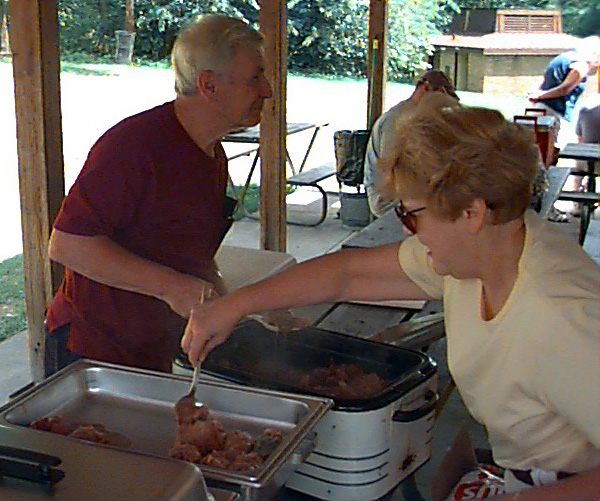 Mom and Pops serve up stuffed cabbages (aka Hunky hand grenades) at a family reunion several years ago.